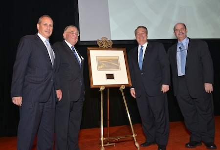 Regional Plan Association presents Howard Milstein with original artwork from the first RPA planning document. Taking part in the presentation are Elliot Sander (Chairman, RPA; President and CEO, HAKS Group, Inc.), John Zuccotti (Chairman, U.S. Commercial Operations, Brookfield Office Properties Co.; Member, RPA Board), Howard Milstein, and Robert Yaro (President, RPA) (left to right).