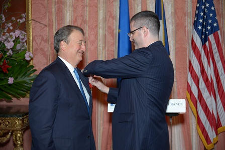 Ambassador Delattre bestowing the badge of a Chevalier of the Legion of Honor on Howard Milstein.