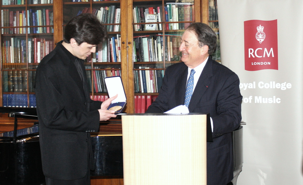 Nikita Abrosimov, 2014 recipient of the Milstein Medal, with Howard Milstein