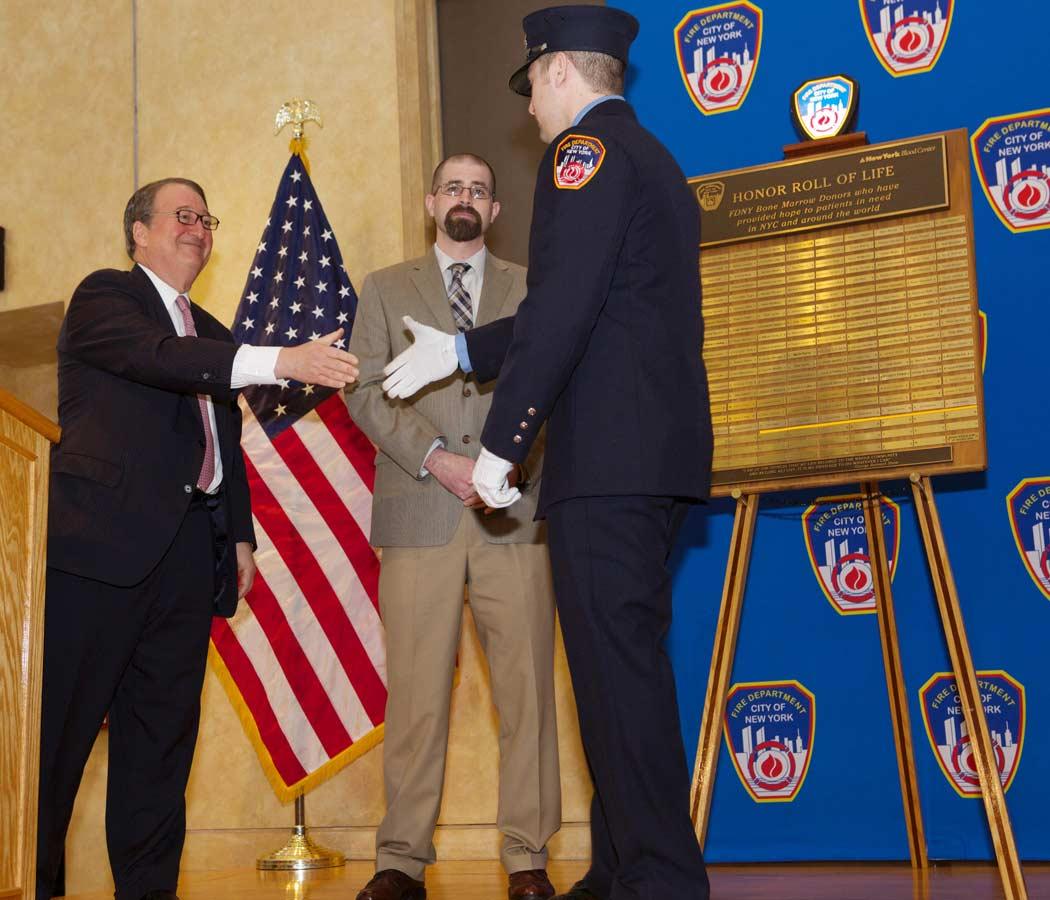 Howard Milstein (left), U.S. Marine veteran Aaron Faulkner (center), and Firefighter Michael McCauley