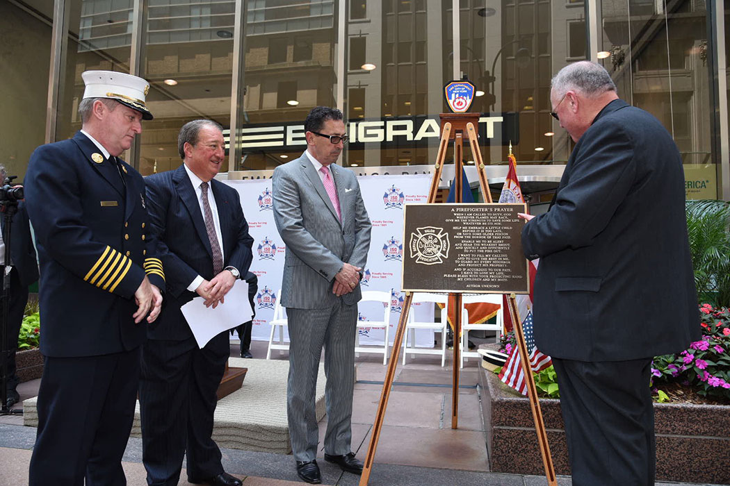 TImothy Cardinal Dolan blesses the plaque of <em>A Firefighter's Prayer</em>