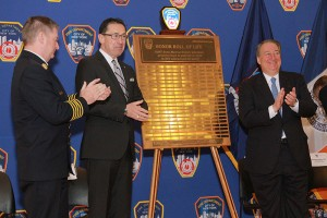 Fire Commissioner Daniel A. Nigro and Howard P. Milstein, Chairman of the New York Blood Center stand on either side of the plaque honoring FDNY bone marrow donors to the Honor Role of Life